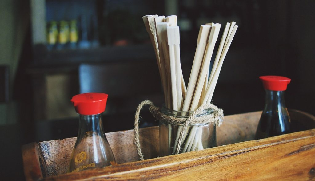 chopsticks, soy sauce, sushi